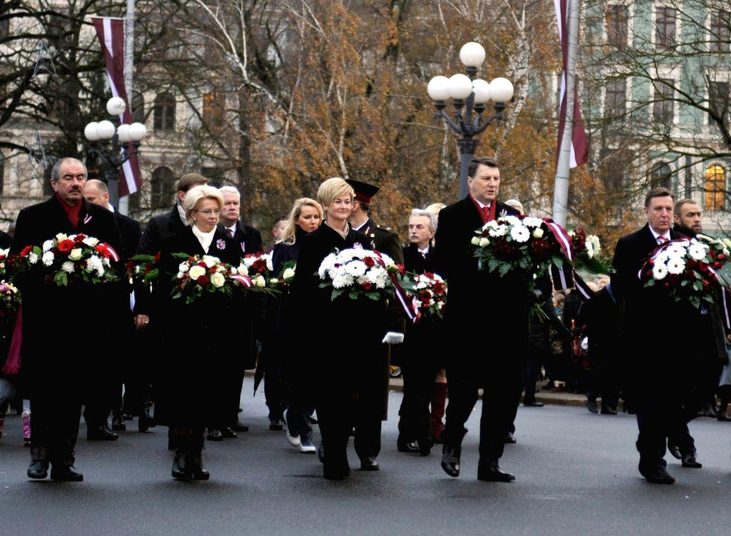 RIGA, Nov. 19, 2016 - Latvian President Raimonds Vejonis (2nd R), Parliament Speaker Inara Murniece (2nd L), Prime Minister Maris Kucinskis (1st R) present flowers to the Freedom Monument in Riga, ... - Inara Murniece