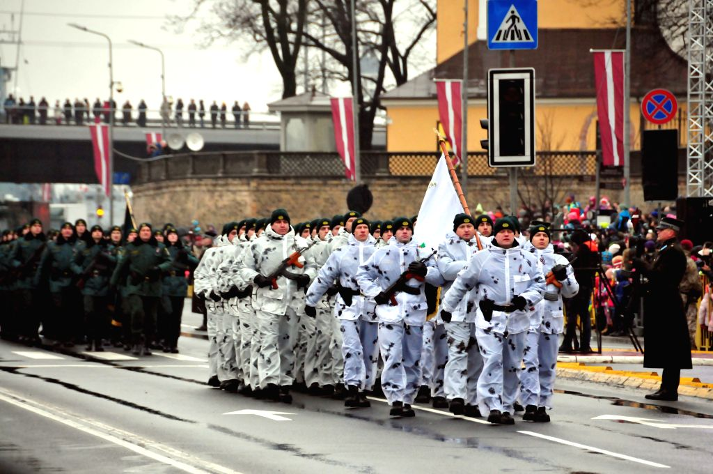 RIGA, Nov. 19, 2016 - Soldiers march during a military parade marking the 98th anniversary of Latvia's independence in Riga, capital of Latvia, Nov. 18, 2016.