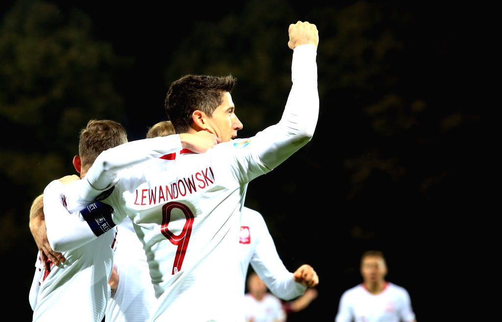 RIGA, Oct. 11, 2019 - Poland's Robert Lewandowski (front) celebrates with his teammates during the UEFA Euro 2020 qualifying round Group G match between Latvia and Poland in Riga, Latvia, Oct. 10, ...