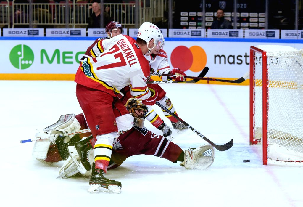 RIGA, Oct. 30, 2019 - Goalkeeper Alexander Salak (bottom) of Riga Dinamo fails to save during the 2019-2020 Kontinental Hockey League (KHL) ice hockey tournament between Riga Dinamo and Kunlun Red ...