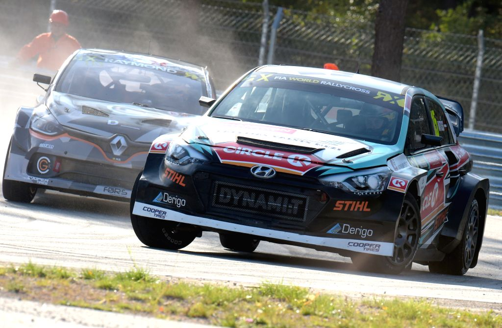 RIGA, Sept. 15, 2019 - Reinis Nitiss (R) of Latvia competes during the qualifying race of the Neste World RX of Latvia, in Riga, Latvia, Sep. 14, 2019.
