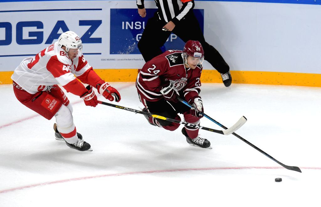 RIGA, Sept. 3, 2019 - David Ullstrom (R) of Riga Dinamo vies with Andrei Kuteikin of Moscow Spartak during the 2019-2020 Kontinental Hockey League (KHL) ice hockey match in Riga, Latvia, Sept. 2, ...