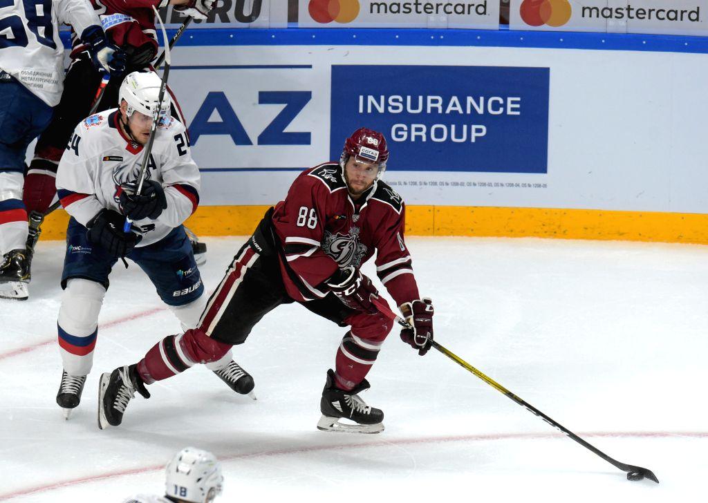 RIGA, Sept. 5, 2019 - Brandon McMillan (R) of Riga Dinamo competes during the 2019-2020 KHL ice hockey match between Riga Dinamo and Nizhny Novgorod Torpedo in Riga, Latvia, Sept. 4, 2019.