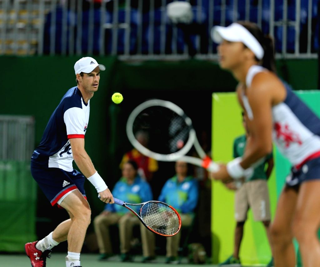 Rio de Janeiro: Andy Murray and Heather Watson of Britain in action against India's Sania Mirza and Rohan Bopanna in mixed doubles tennis event in Rio de Janeiro on Aug. 12, 2016. Sania and Bopanna ... - Sania Mirza and Rohan Bopanna