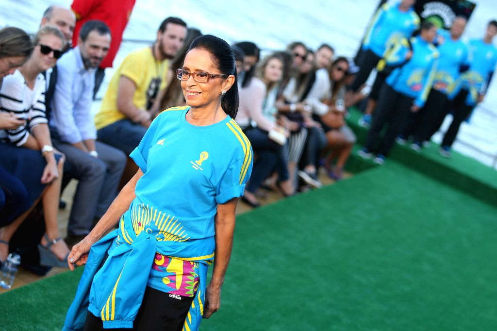 A volunteer presents the uniform designed for FIFA World Cup volunteers on a fashion show during Fashion Rio event in Rio de Janeiro, Brazil, on April 10, ..