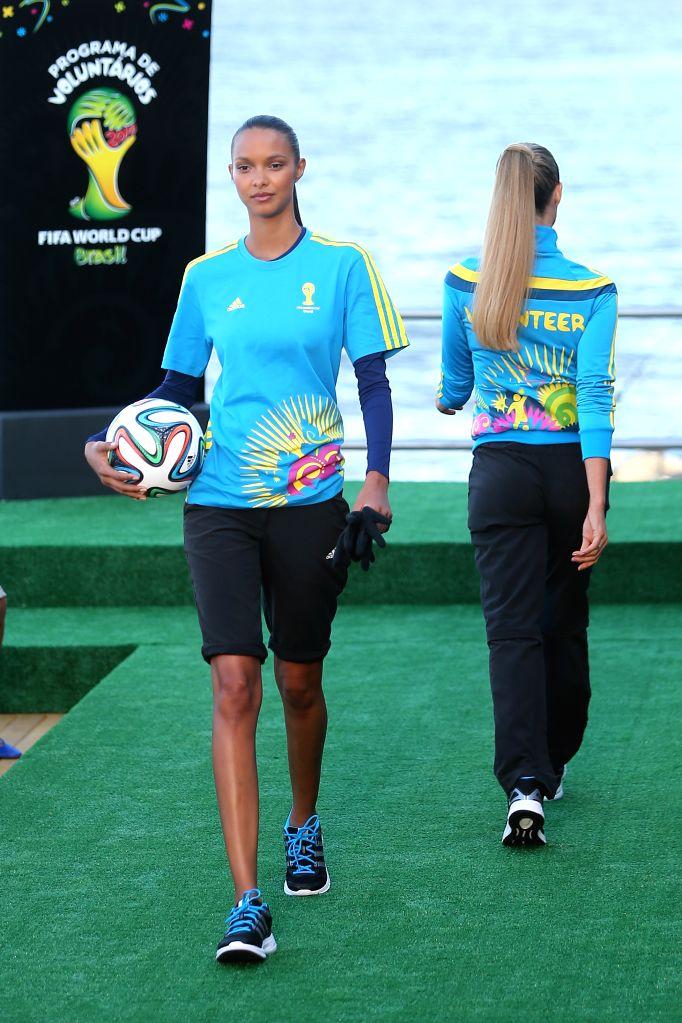 Brazilian model Lais Ribeiro (L) presents the uniform designed for FIFA World Cup volunteers on a fashion show during Fashion Rio event in Rio de Janeiro, .. - Lais Ribeiro