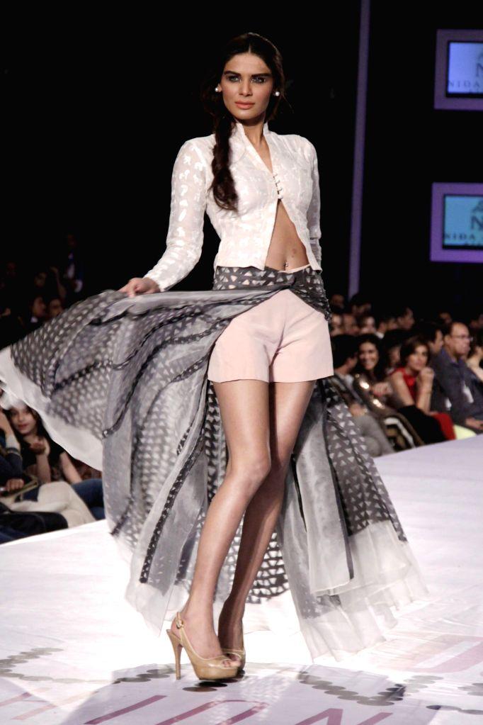 A model presents fashion creation of Filhas de Gaia brand on a fashion show of Fashion Rio event in Rio de Janeiro, Brazil, on April 11, 2014. Fashion Rio ..