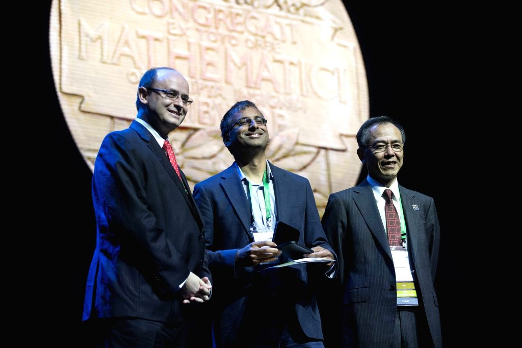 RIO DE JANEIRO, Aug. 1, 2018 - The Fields Medal winner Akshay Venkatesh (C) of India is awarded during the opening ceremony of the 2018 International Congress of Mathematicians in Rio de Janeiro, ...