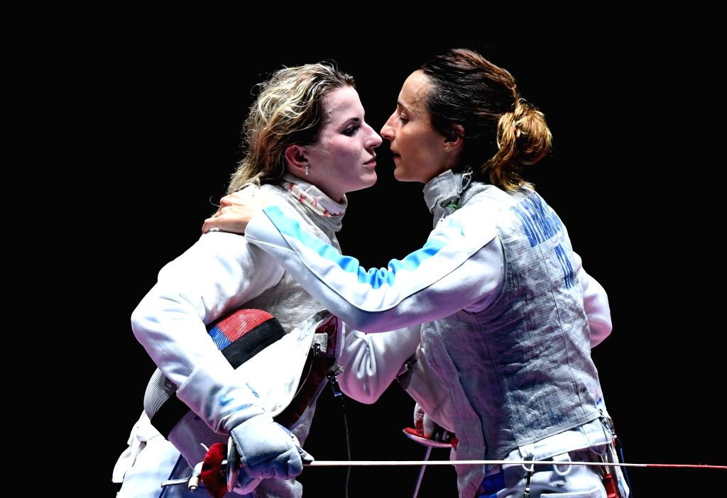 RIO DE JANEIRO, Aug. 10, 2016 - Inna Deriglazova (L) of Russia greets Elisa Di Francisca of Italy during the women's foil individual final of fencing at the 2016 Rio Olympic Games in Rio de Janeiro, ...