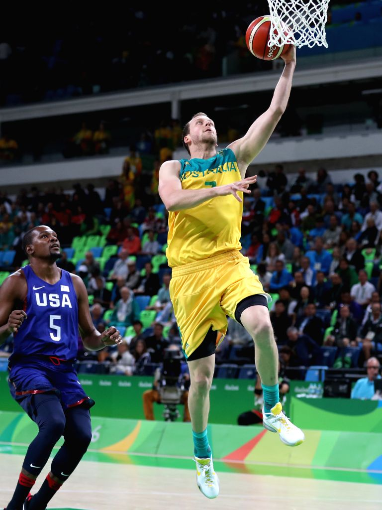 RIO DE JANEIRO, Aug. 10, 2016 - Joe Ingles (R) of Australia goes up for a shot against Kevin Durant from the United States of America during a men's preliminary round match of basketball at the 2016 ...