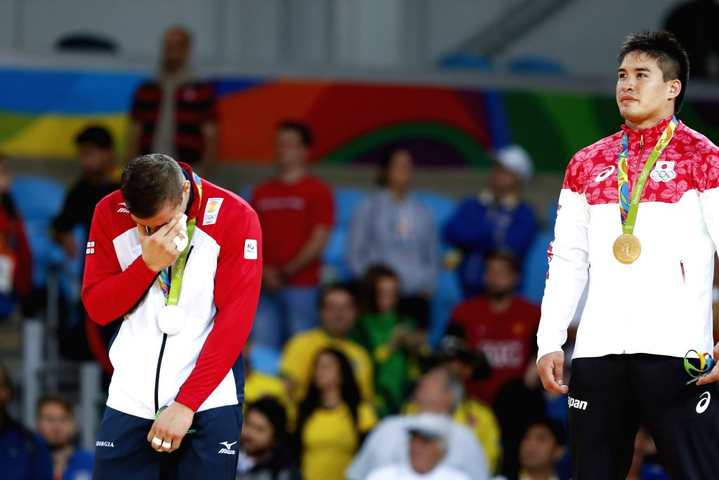 RIO DE JANEIRO, Aug. 10, 2016 - Varlam Liparteliani (L) of Georgia cries at the awarding ceremony of the men's 90KG judo final at the 2016 Rio Olympic Games in Rio de Janeiro, Brazil, on Aug. 10, ...