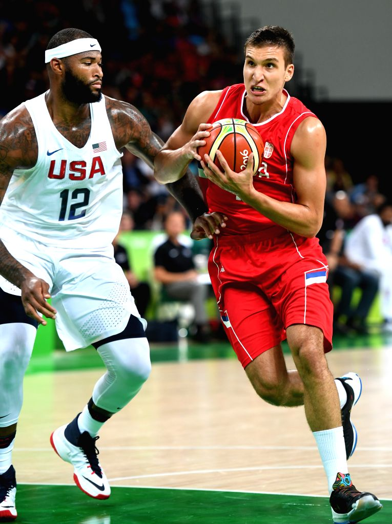 RIO DE JANEIRO, Aug. 12, 2016 - Bogdan Bogdanovic of Serbia (R) competes during the men's basketball preliminary round group A between the United States and Serbia at the 2016 Rio Olympic Games in ...
