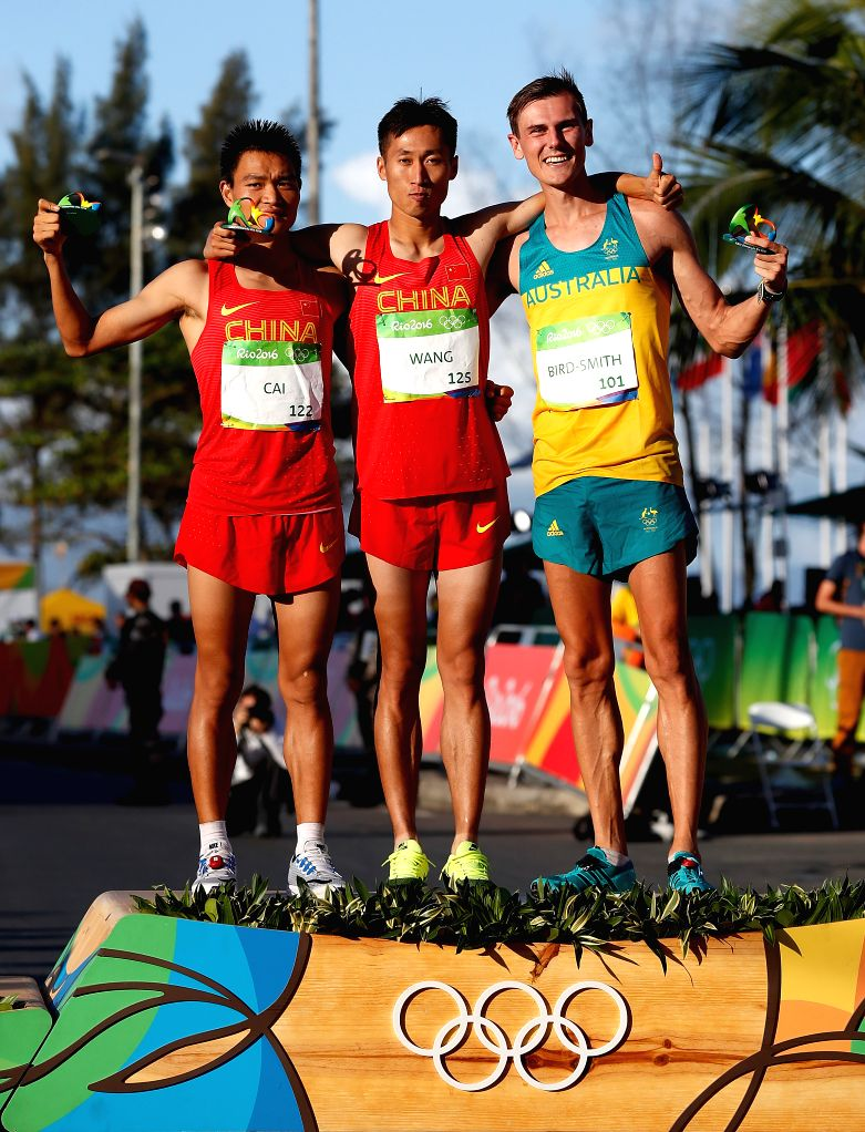 RIO DE JANEIRO, Aug. 12, 2016 - Cai Zelin (L) and Wang Zhen (C) of China and Dane Bird-Smith of Australia celebrate after the men's 20km race walk of Athletics at the 2016 Rio Olympic Games in Rio de ...