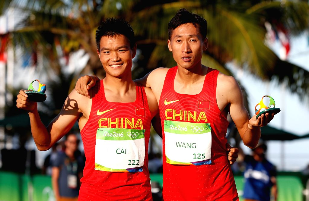 RIO DE JANEIRO, Aug. 12, 2016 - Cai Zelin (L) and Wang Zhen of China celebrate after the men's 20km race walk of Athletics at the 2016 Rio Olympic Games in Rio de Janeiro, Brazil, on Aug. 12, 2016.  ...
