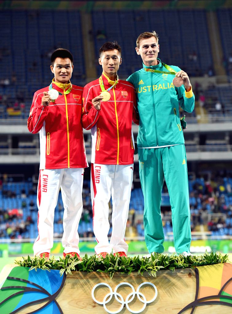 RIO DE JANEIRO, Aug. 12, 2016 - Cai Zelin (L) and Wang Zhen (C) of China and Dane Bird-Smith of Australia celebrate at the awarding ceremony of men's 20km race walk of Athletics at the 2016 Rio ...