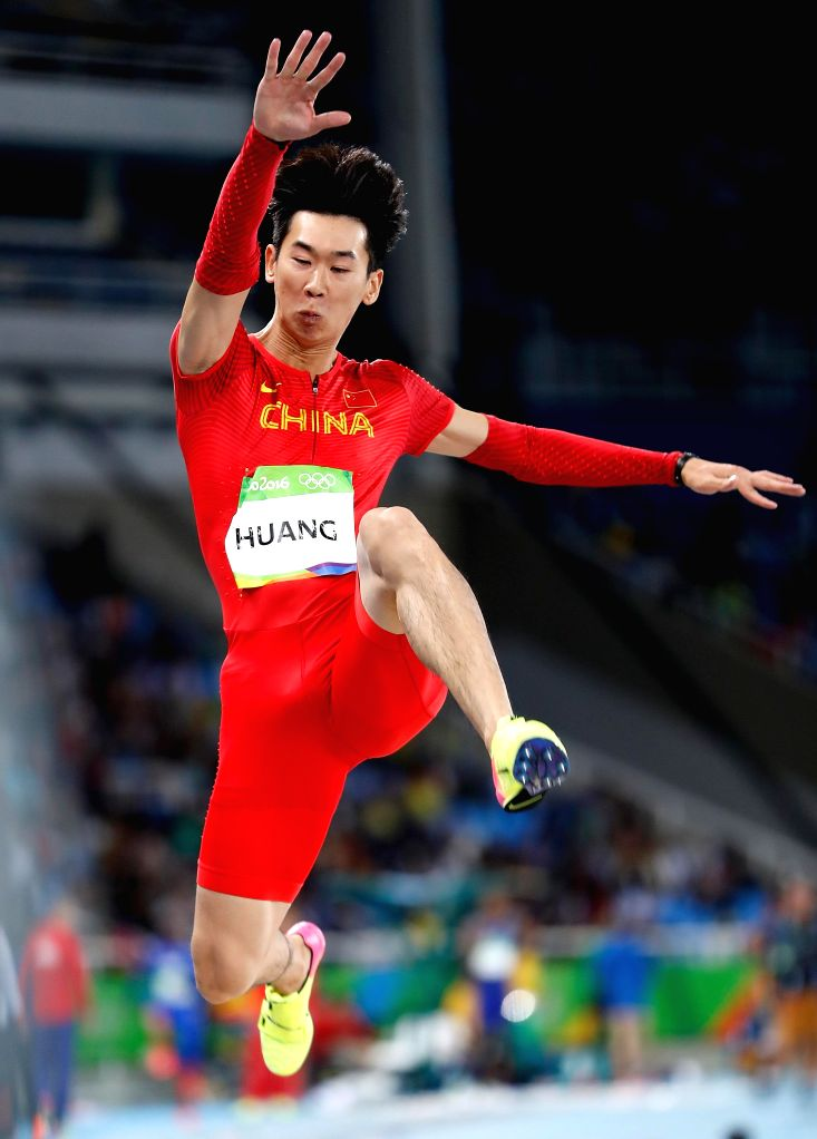 RIO DE JANEIRO, Aug. 12, 2016 - China's Huang Changzhou competes during the men's long jump qualification at the 2016 Rio Olympic Games in Rio de Janeiro, Brazil, on Aug. 12, 2016.
