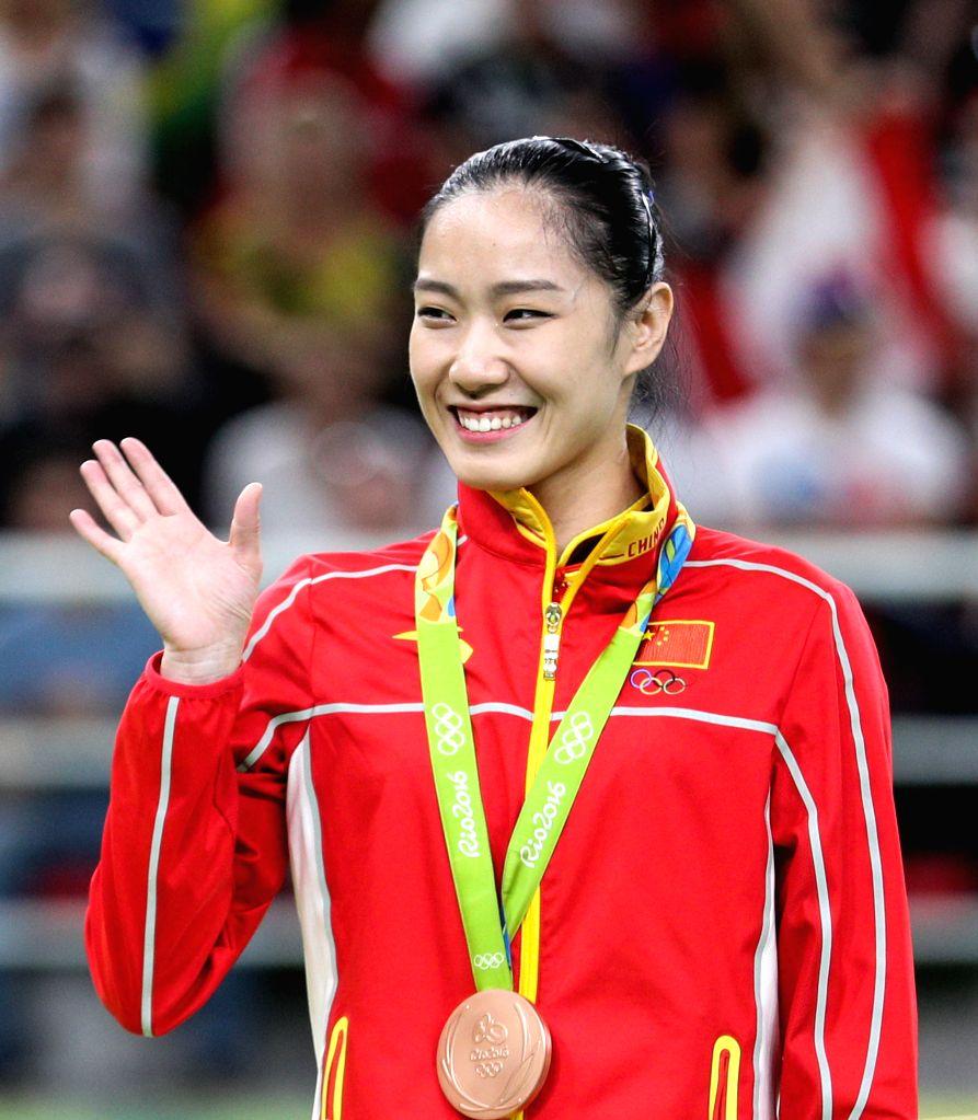 RIO DE JANEIRO, Aug. 12, 2016 - China's li Dan attends the awarding ceremony for women's final of trampoline gymnastics at the 2016 Rio Olympic Games in Rio de Janeiro, Brazil, on Aug. 12, 2016. li ...