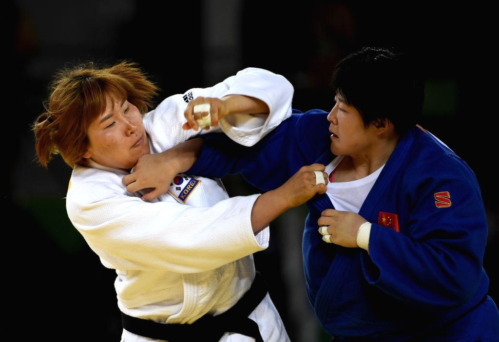 RIO DE JANEIRO, Aug. 12, 2016 - China's Yu Song (R) competes with South Korea's Kim Minjeong during the women's +78kg contest for bronze medal of Judo at the 2016 Rio Olympic Games in Rio de Janeiro, ...