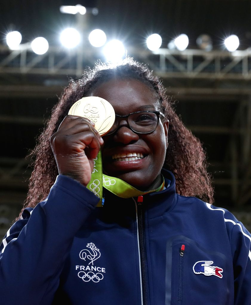 RIO DE JANEIRO, Aug. 12, 2016 - Emilie Andeol of France reacts at the awarding ceremony for the women's +78KG final of Judo at the 2016 Rio Olympic Games in Rio de Janeiro, Brazil, on Aug. 11, 2016. ...