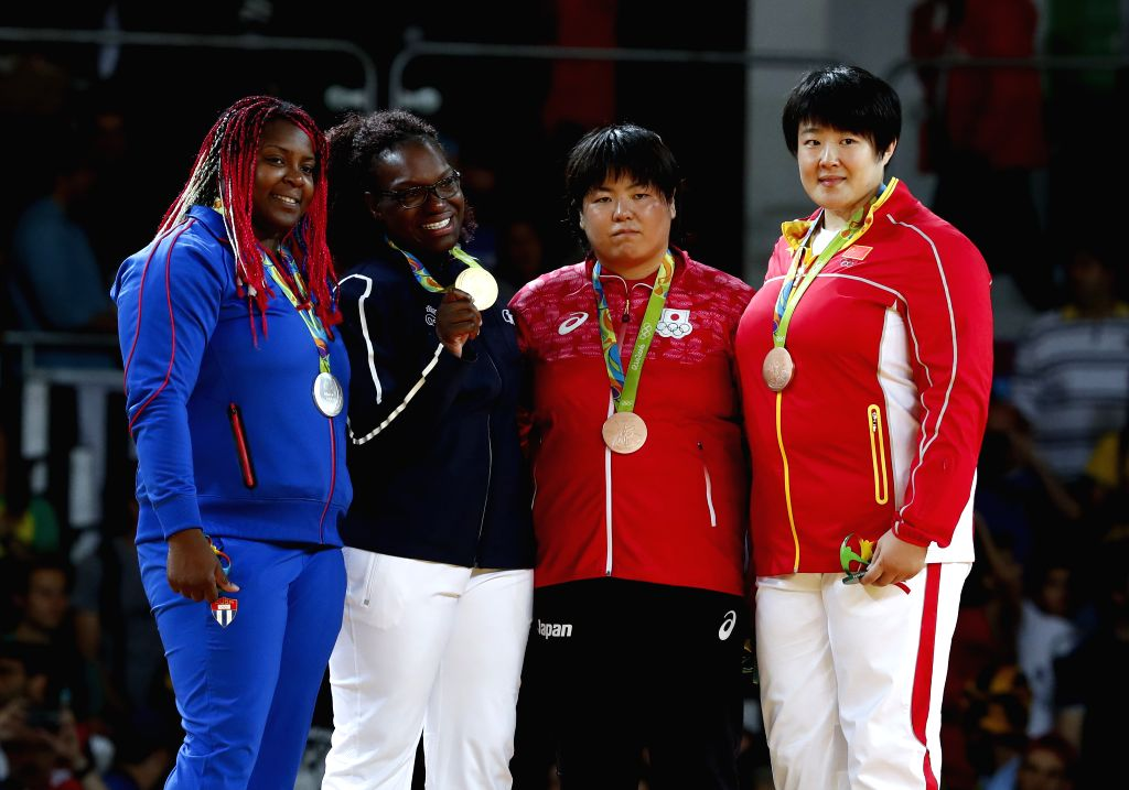 RIO DE JANEIRO, Aug. 12, 2016 - Gold medalist Emilie Andeol of France(2nd L), silver medalist Idalys Ortiz of Cuba (1st L), bronze medalists Yu Song of China (1st R) and Yamabe Kanae of Japan pose ...