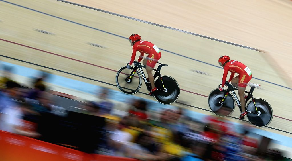 RIO DE JANEIRO, Aug. 12, 2016 - Gong Jinjie (L) and Zhong Tianshi of China compete during the women's team sprint final of cycling track at the 2016 Rio Olympic Games in Rio de Janeiro, Brazil, on ...