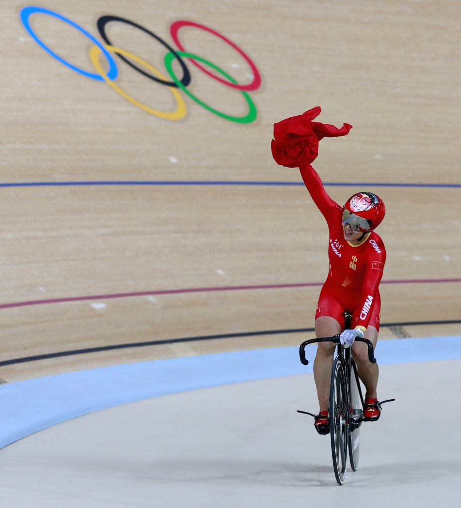 RIO DE JANEIRO, Aug. 12, 2016 - Gong Jinjie of China celebrates after the women's team sprint final of cycling track at the 2016 Rio Olympic Games in Rio de Janeiro, Brazil, on Aug. 12, 2016. China ...