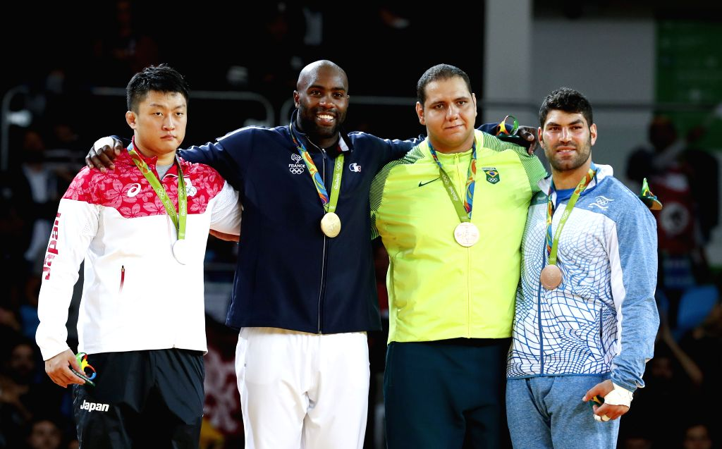 RIO DE JANEIRO, Aug. 12, 2016 - Harasawa Hisayoshi of Japan,Teddy Riner of France,Rafael Silva of Brazil and Or Sasson of Israel (from L to R) celebrate at the awarding ceremony for the men's +100KG ...