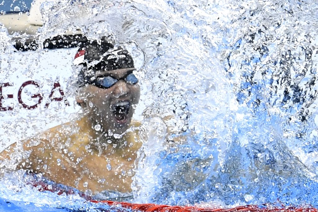 RIO DE JANEIRO, Aug. 12, 2016 - Joseph Schooling of Singapore celebrates after the men's 100m butterfly final at the 2016 Rio Olympic Games in Rio de Janeiro, Brazil, on Aug. 12, 2016. Joseph ...