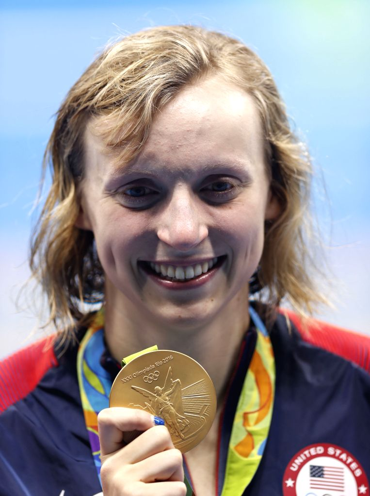 RIO DE JANEIRO, Aug. 12, 2016 - Katie Ledecky of the United States celebrates at the awarding ceremony of the women's 800m freestyle final at the 2016 Rio Olympic Games in Rio de Janeiro, Brazil, on ...