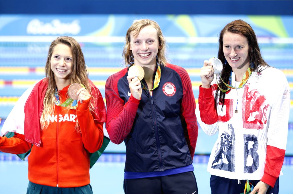 RIO DE JANEIRO, Aug. 12, 2016 - Katie Ledecky of the United States (C), Jazz Carlin of Great Britain (L) and Boglarka Kapas of Hungary celebrate at the awarding ceremony of the women's 800m freestyle ...