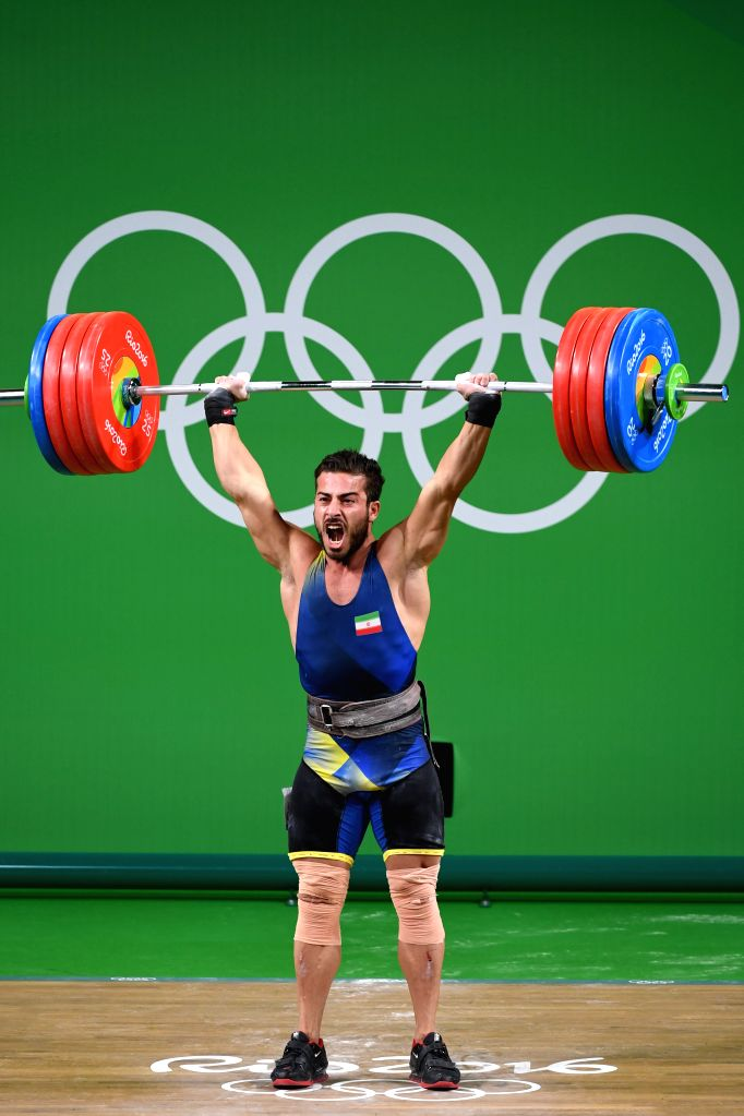 RIO DE JANEIRO, Aug. 12, 2016 - Kianoush Rostami of Iran competes during the men's weightlifting 85KG group A competition at the 2016 Rio Olympic Games in Rio de Janeiro, Brazil, on Aug. 12, 2016. ...