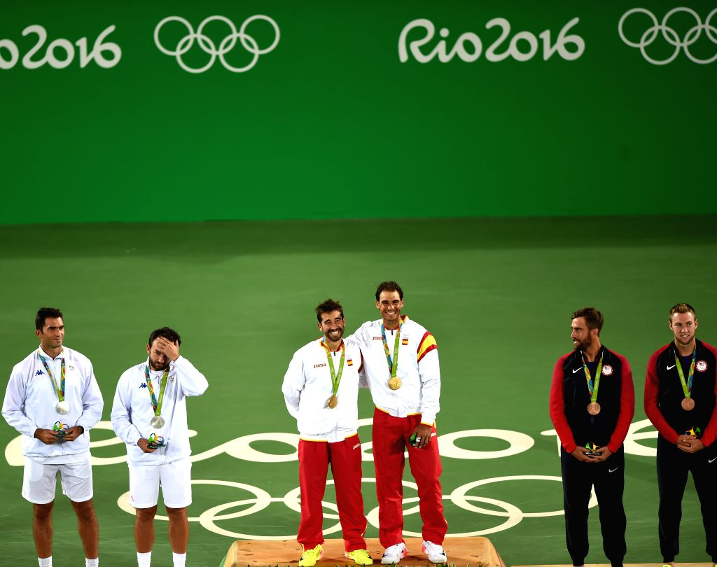 RIO DE JANEIRO, Aug. 12, 2016 - Rafael Nadal (4th L) and Marc Lopez (3th L) of Spain celebrate at the awarding ceremony of men's doubles tennis at the 2016 Rio Olympic Games in Rio de Janeiro, ...