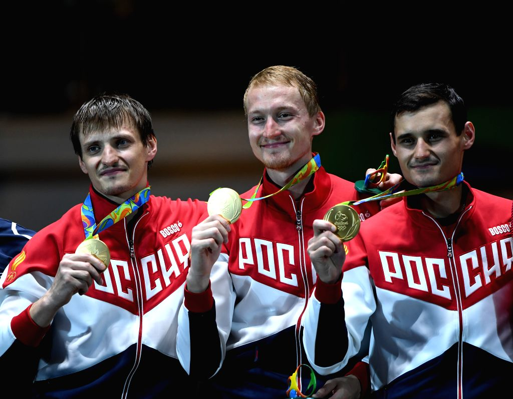 RIO DE JANEIRO, Aug. 12, 2016 - Russia's athletes attend the awarding ceremony for the men's foil team final of fencing at the 2016 Rio Olympic Games in Rio de Janeiro, Brazil, on Aug. 12, 2016. ...