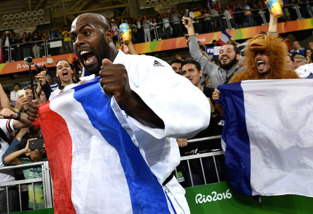 RIO DE JANEIRO, Aug. 12, 2016 - Teddy Riner of France celebrates after the men's +100KG final of Judo at the 2016 Rio Olympic Games in Rio de Janeiro, Brazil, on Aug. 12, 2016. Teddy Riner won the ...