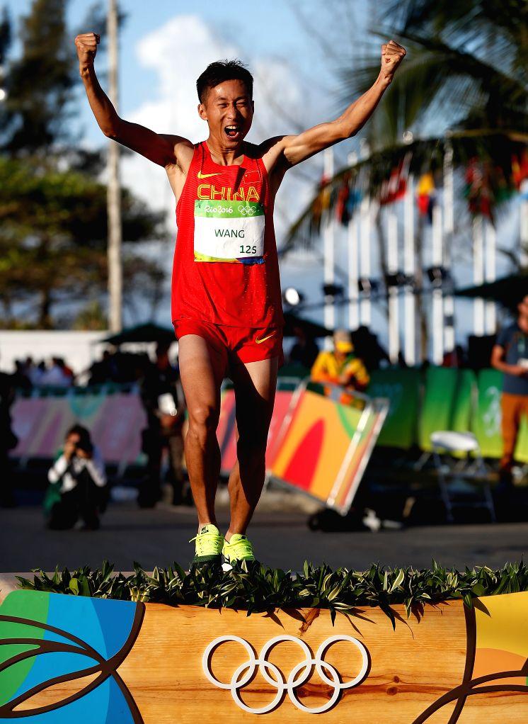 RIO DE JANEIRO, Aug. 12, 2016 - Wang Zhen of China celebrates after the men's 20km race walk of Athletics at the 2016 Rio Olympic Games in Rio de Janeiro, Brazil, on Aug. 12, 2016. Wang Zhen won the ...