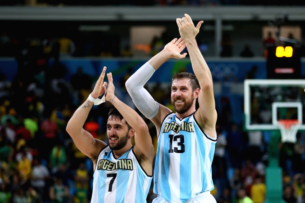 RIO DE JANEIRO, Aug. 13, 2016 - Argentina's Facundo Campazzo (L) and Andres Nocioni celebrate after a men's preliminary round group B match of Basketball between Argentina and Brazil at the 2016 Rio ...