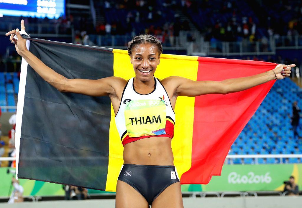 RIO DE JANEIRO, Aug. 13, 2016 - Belgian Nafissatou Thiam celebrates after Women's Heptathlon 800m heat of the Rio 2016 Olympic Games at Olympic Stadium in Rio de Janeiro, Brazil, on Aug. 13, 2016. ...