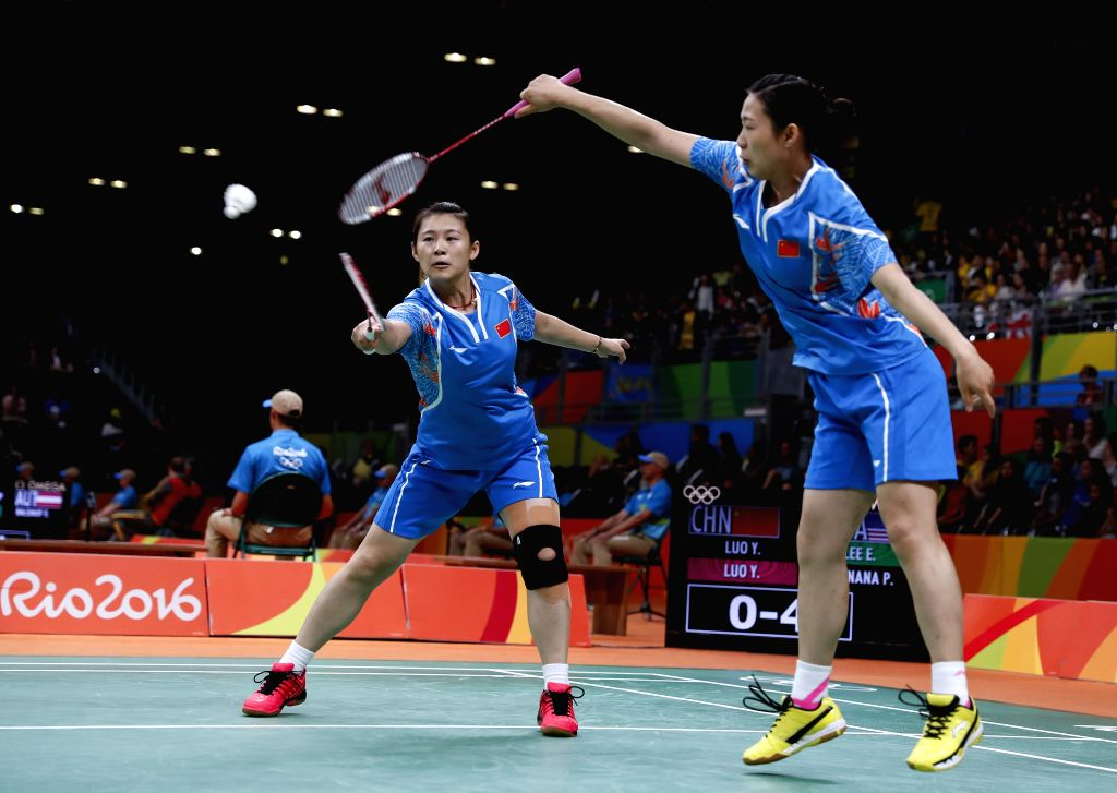 RIO DE JANEIRO, Aug. 13, 2016 - China's Luo Ying (L) and Luo Yu compete against Eva Lee and Paula Lynn Obanana of the United States of America during a women's doubles group play stage match of ...