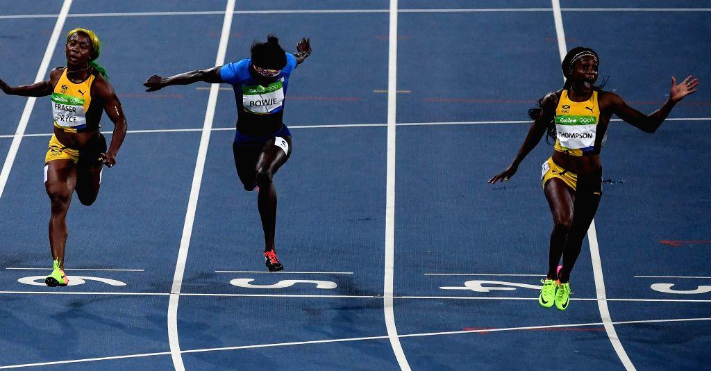 RIO DE JANEIRO, Aug. 13, 2016 - Elaine Thompson (1st R) of Jamaica competes during the final of women's 100m at the 2016 Rio Olympic Games in Rio de Janeiro, Brazil, on Aug. 13, 2016. Elaine Thompson ...