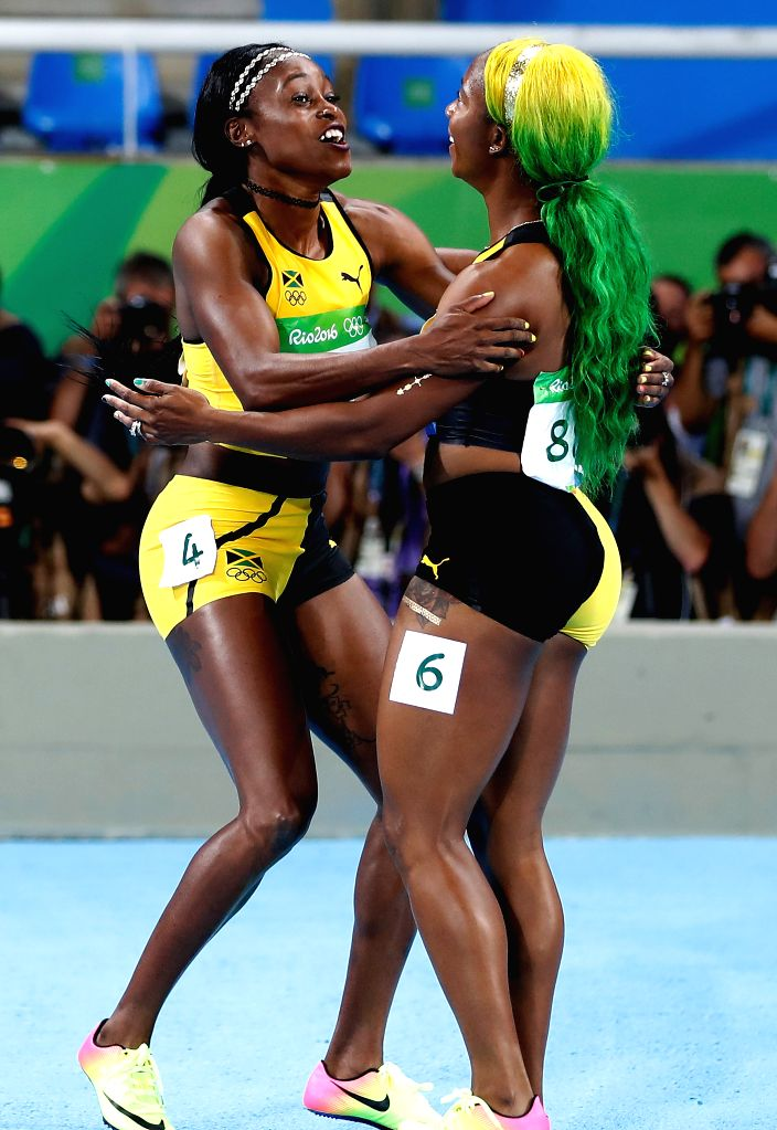 RIO DE JANEIRO, Aug. 13, 2016 - Elaine Thompson (L) of Jamaica celebrates with Shelly-Ann Fraser-Pryce of Jamaica after the final of women's 100m at the 2016 Rio Olympic Games in Rio de Janeiro, ...