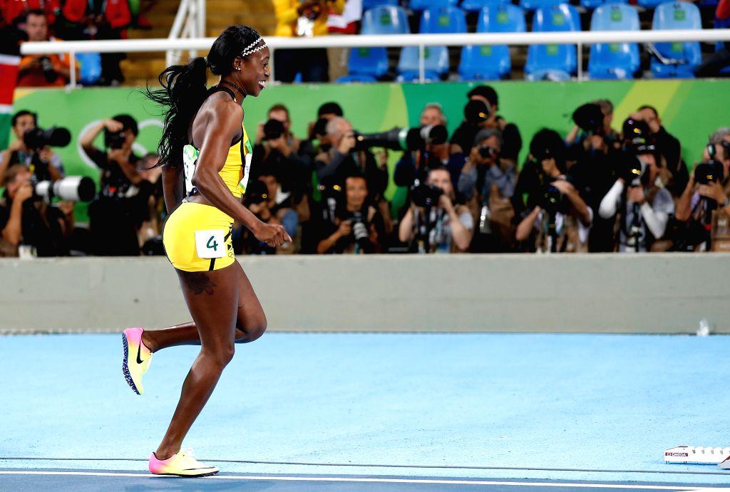 RIO DE JANEIRO, Aug. 13, 2016 - Elaine Thompson of Jamaica celebrates after the final of women's 100m at the 2016 Rio Olympic Games in Rio de Janeiro, Brazil, on Aug. 13, 2016. Elaine Thompson won ...