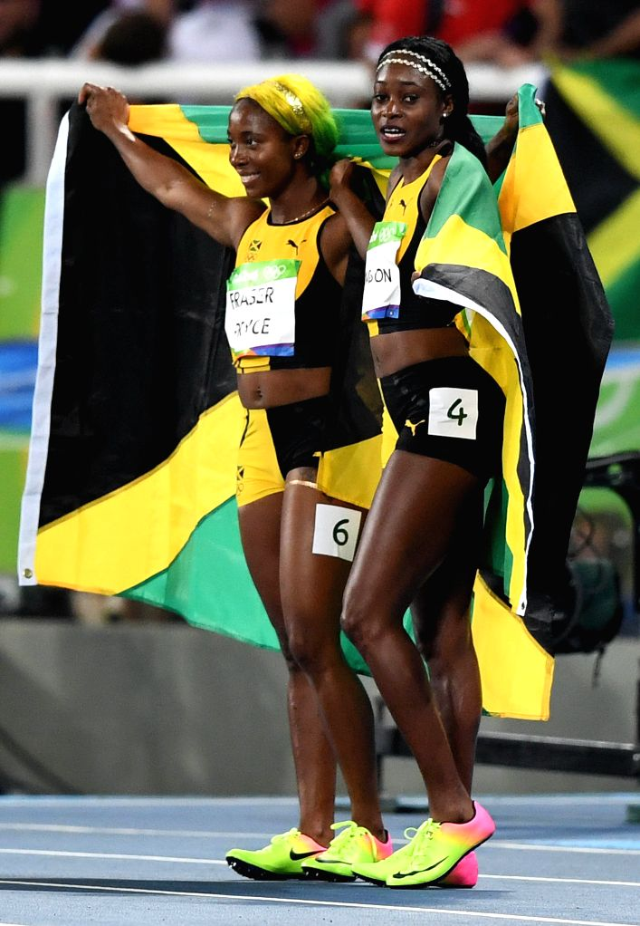 RIO DE JANEIRO, Aug. 13, 2016 - Elaine Thompson (R) and Shelly-Ann Fraser-Pryce of Jamaica celebrate after the final of women's 100m at the 2016 Rio Olympic Games in Rio de Janeiro, Brazil, on Aug. ...