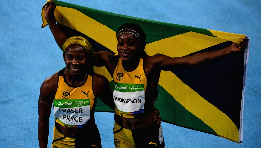RIO DE JANEIRO, Aug. 13, 2016 - Elaine Thompson (R) of Jamaica celebrates with Shelly-Ann Fraser-Pryce of Jamaica after the final of women's 100m at the 2016 Rio Olympic Games in Rio de Janeiro, ...
