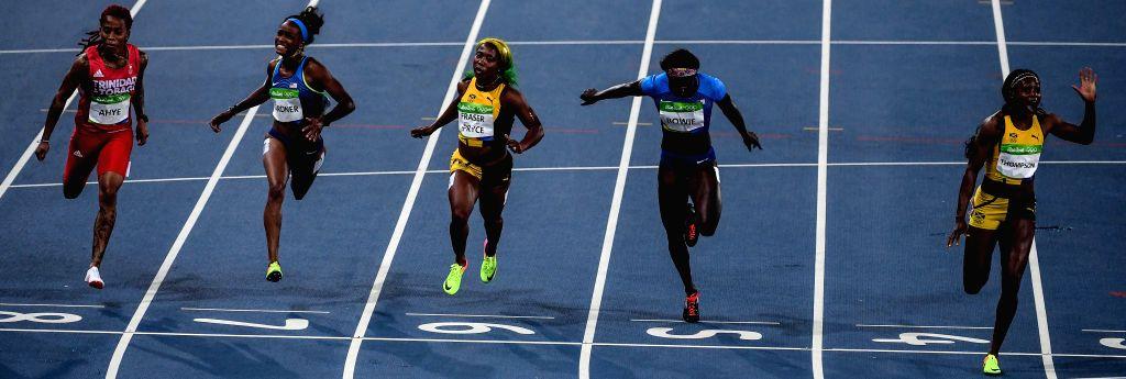 RIO DE JANEIRO, Aug. 13, 2016 - Elaine Thompson (R) of Jamaica competes during the final of women's 100m at the 2016 Rio Olympic Games in Rio de Janeiro, Brazil, on Aug. 13, 2016. Elaine Thompson won ...