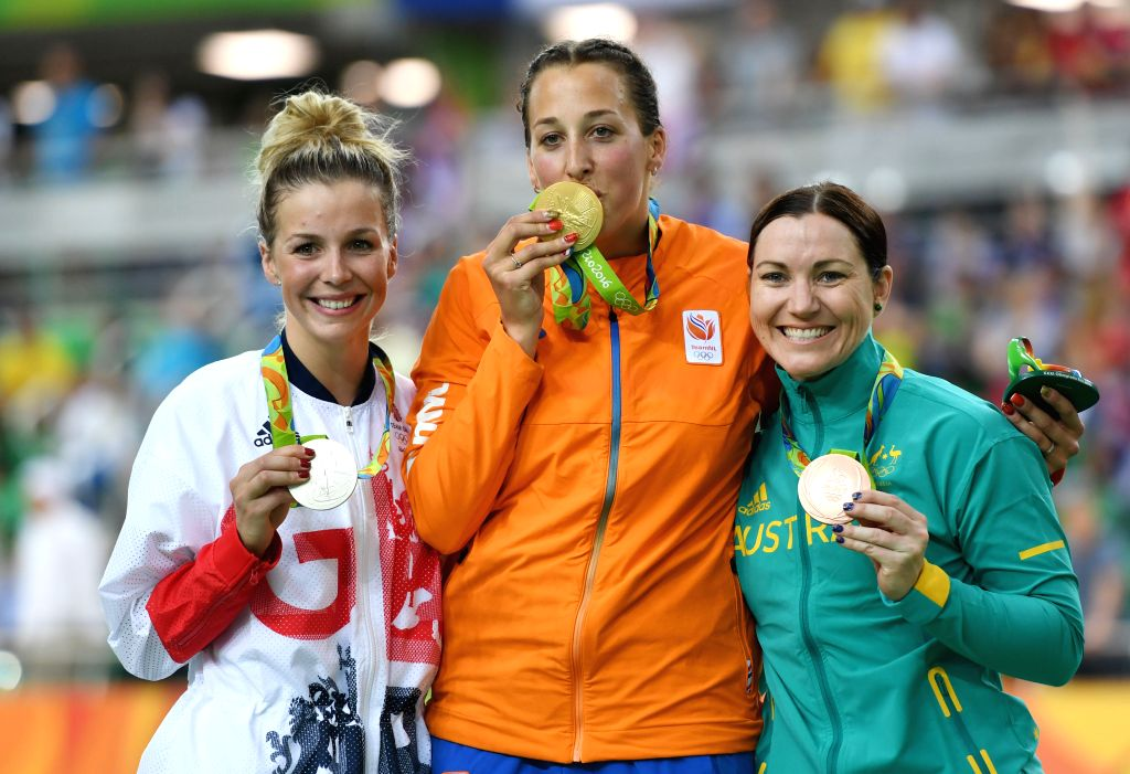 RIO DE JANEIRO, Aug. 13, 2016 - Elis Ligtlee of Netherlands (C), Rebecca James of Great Britain (L) and Anna Meares of Australia celebrate at the awarding ceremony of the women's keirin final 1-6 of ...