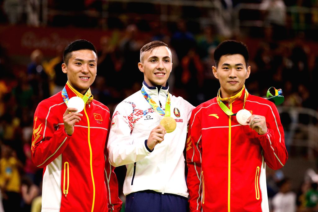 RIO DE JANEIRO, Aug. 13, 2016 - Gold medalist Belarus's Uladzislau Hancharou (C), silver medalist  China's Dong Dong (L), bronze medalist China's Gao Lei attend the awarding ceremony for the men's ...