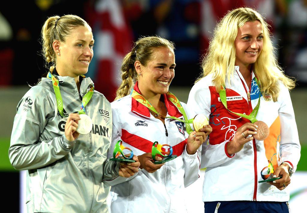 RIO DE JANEIRO, Aug. 13, 2016 - Gold medalist Puerto Rico's Monica Puig (C), silver medalist Germany's Angelique Kerber (L), bronze medalist Czech Republic's Petra Kvitova attend the awarding ...
