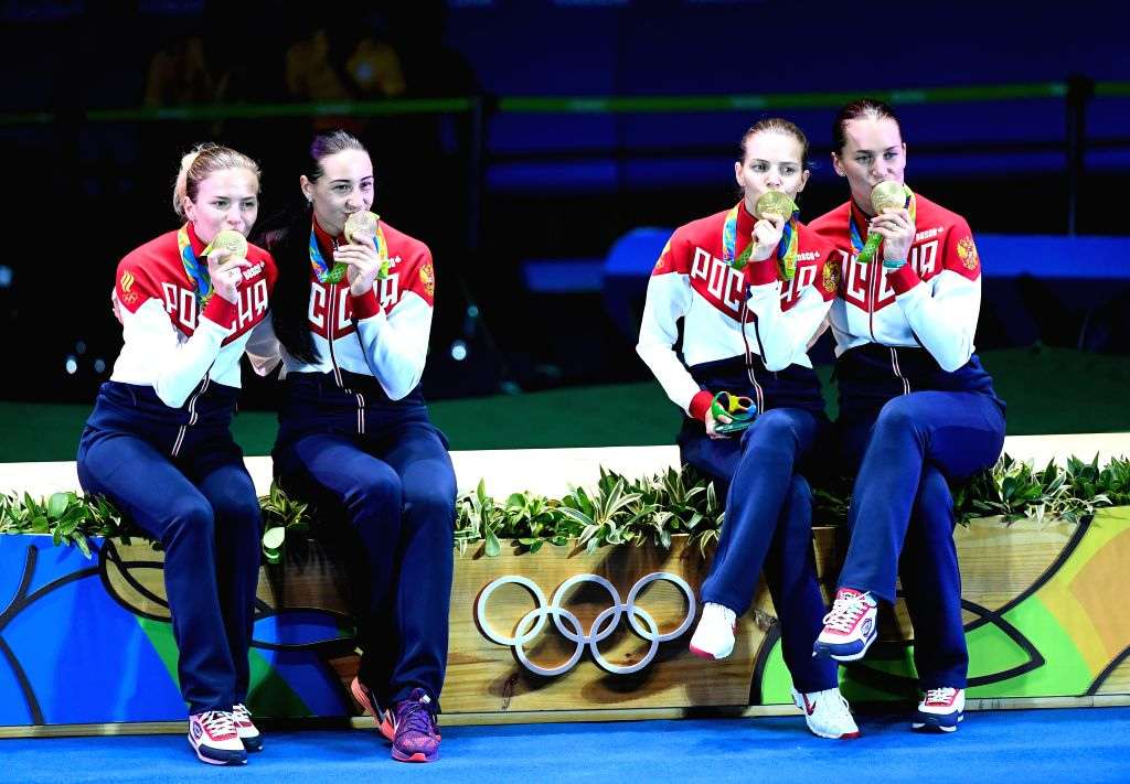 RIO DE JANEIRO, Aug. 13, 2016 - Gold medalists Russia's athletes attend the awarding ceremony for the women's sabre team final of Fencing against Ukraine at the 2016 Rio Olympic Games in Rio de ...