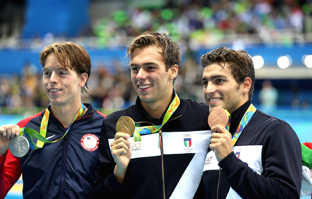 RIO DE JANEIRO, Aug. 13, 2016 - Gregorio Paltrinieri (C) and Gabriele Detti (R) of Italy and Connor Jaeger of the United States attend the awarding ceremony of the men's 1500m freestyle final at the ...