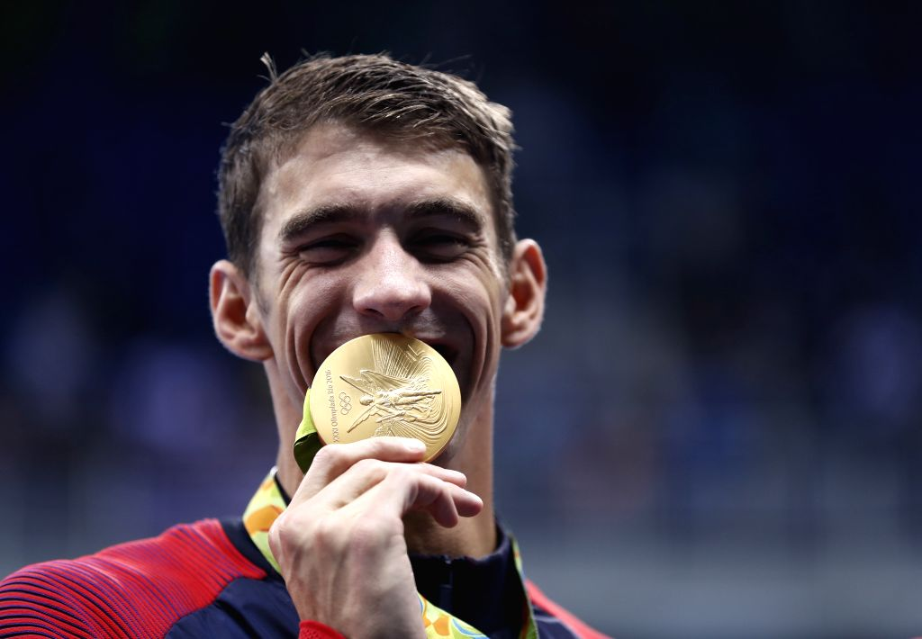 RIO DE JANEIRO, Aug. 13, 2016 - Michael Phelps of the United States shows the gold medal at the awarding ceremony of the men's 4x100m medley relay final at the 2016 Rio Olympic Games in Rio de ...